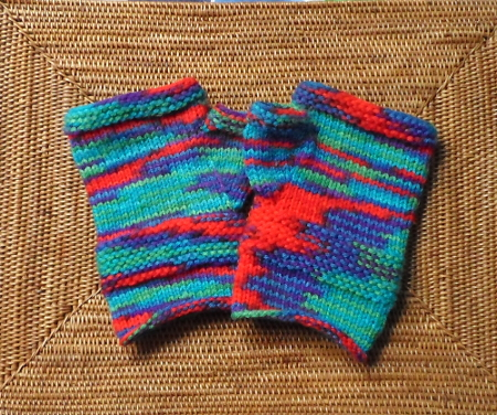 Mittens knitted in a variegated yarn.